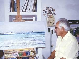 El pintor Rafel Bataller i una de les seues obres.