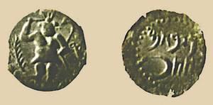 Moneda de la seca d´Eivissa amb una representació del déu Bes.