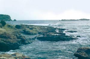 La punta de ses Calderes. Al fons, a l´esquerra, l´illa des Canar. Foto: Enric Ribes i Marí.