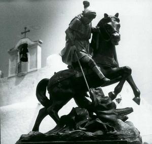 Sant Jordi mata la cuca. Amb el mot hom fa referència popularment al dimoni.
