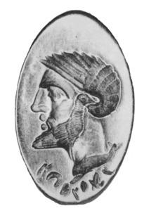 Epigrafia. Anell d´or que representa un cap masculí, amb inscripció neopúnica. Foto: extret de <em>Corpus de las inscripciones fenicias, púnicas y neopúnicas de España</em>.